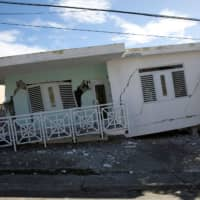 Most Puerto Ricans remain without power, with many sleeping outdoors