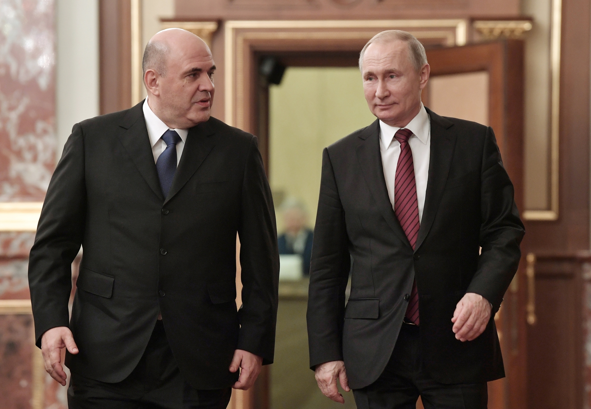 Russian President Vladimir Putin (right) and new Russian Prime Minister Mikhail Mishustin arrive to attend a new cabinet meeting in Moscow Tuesday0. Putin formed his new Cabinet Tuesday, replacing many of its members but keeping his foreign, defense and finance ministers in place. | ALEXEI NIKOLSKY / SPUTNIK / KREMLIN POOL PHOTO / VIA AP