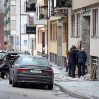 Police work on the site where an explosion damaged a residential building in central Stockholm Monday. | JANERIK HENRIKSSON / TT NEWS AGENCY / VIA REUTERS