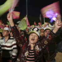Supporters of Taiwan's 2020 presidential election candidate, Taiwan President Tsai Ing-wen of the Democratic Progressive Party (DPP), cheer during a campaign rally in Taipei Sunday. Taiwan will hold its presidential election on Jan. 11. | AP