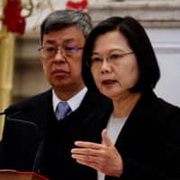 Taiwan President Tsai Ing-wen speaks during a news conference at the presidential office as Vice President Chen Chien-jen looks on in Taipei on Wednesday.   AFP-JIJI