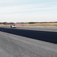 A strip of graphene-enhanced tarmac that is being trialed on Fiumicino Airport's Alpha Alpha runway in Rome | REUTERS