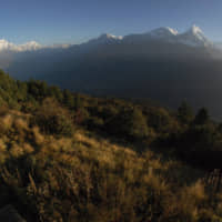 Trekkers watch the sun rise over the Annapurna Range (right) in central Nepal, as viewed from Poon Hill, above the village of Ghorepani in 2014. An avalanche swept the popular Annapurna circuit trekking route, which encircles Mount Annapurna, leaving at least four South Koreans and three Nepali guides missing, authorities said Saturday.   AP