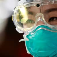 Scientists aim to create Wuhan vaccine in record time