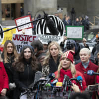Rosanna Arquette speaks at a news conference outside a Manhattan courthouse after Harvey Weinstein arrived Monday in New York. Behind her are (left to right) Louise Godbold, Dominique Huett, Sarah Ann Masse, Paula Williams, Rose McGowan and Lauren Sivan. | AP