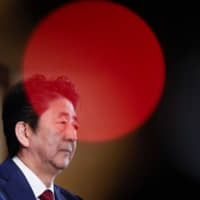 Prime Minister Shinzo Abe is expected to face a barrage of questions from the opposition over a number of scandals when the Diet opens Monday. | AFP-JIJI