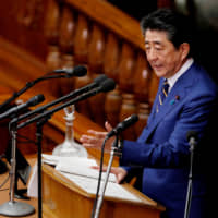 Prime Minister Shinzo Abe gives a policy speech at the start of the regular session of the Diet in Tokyo on Monday. | REUTERS