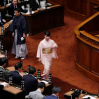 Lawmakers wearing kimono arrive for the start of the regular session of the Diet on Monday. | REUTERS