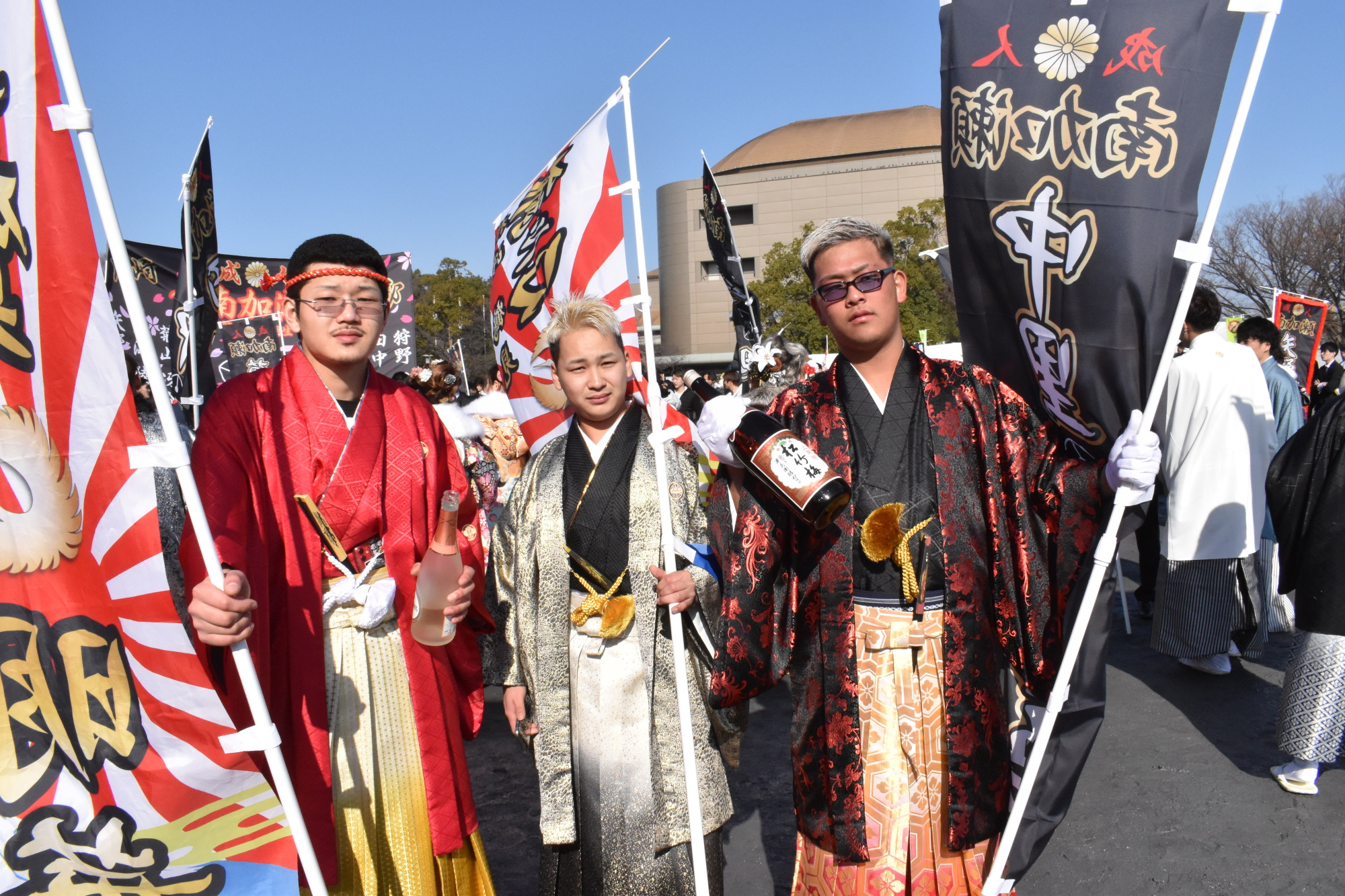 Three men wearing traditional hakama pants stand out at a coming-of-age ceremony in Kawasaki on Monday. Most men attending the event dressed in suits while women wore kimono to celebrate attaining adulthood. | TOMOHIRO OSAKI