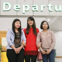 Nursing care workers from Myanmar set to participate in Japan's foreign trainee program are pictured before departing from Yangon in January last year. | KYODO