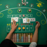 Following a casino-related bribery scandal that erupted in December, Prime Minister Shinzo Abe's government finds itself facing increased public opposition to casinos, which could delay the introduction of so-called integrated resorts in Japan. | AFP-JIJI
