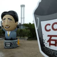 Japan is in the climate crosshairs, as it seeks to be recognized as a leader in the climate change debate but also supports the use of coal, widely regarded as a dirty fuel. | BLOOMBERG