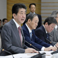 Prime Minister Shinzo Abe speaks at his office in Tokyo Friday during a government meeting on steps to deal with China's deadly new coronavirus.  | KYODO