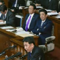 Opposition parties lay into Abe over scandals and Mideast dispatch