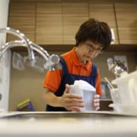 Japan to urge firms to employ workers until age 70 from next year