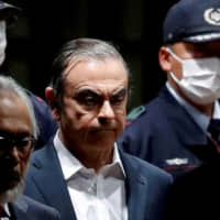 Former Nissan Chariman Carlos Ghosn leaves the Tokyo Detention House last April.   REUTERS