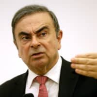 Former Nissan Chairman Carlos Ghosn gestures during a news conference at the Lebanese Press Syndicate in Beirut on Wednesday. | REUTERS