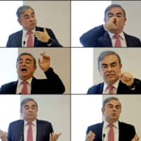 Former Renault-Nissan boss Carlos Ghosn gestures as he addresses a large crowd of journalists on his reasons for dodging trial in Japan, where he is accused of financial misconduct, at the Lebanese Press Syndicate in Beirut on Wednesday. | AFP-JIJI