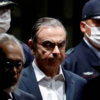 Former Nissan Motor Chairman Carlos Ghosn leaves the Tokyo Detention House on April 25. | REUTERS