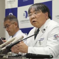 Yoshiki Sawa, a professor in Osaka University's cardiovascular surgery unit, holds a news conference Monday in Suita, Osaka Prefecture, about the world's first transplant of cardiac muscle cells created from induced pluripotent stem cells. | KYODO