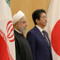 Iranian President Hassan Rouhani and Prime Minister Shinzo Abe meet in Tokyo on Dec. 20.   VIA REUTERS