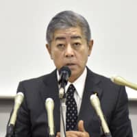 Former Defense Minister Takeshi Iwaya faces the media during a news conference Saturday in his home electoral district in Beppu, Oita Prefecture, over his suspected involvement in a high-profile casino-bribery case that has rocked the ruling Liberal Democratic Party. | KYODO