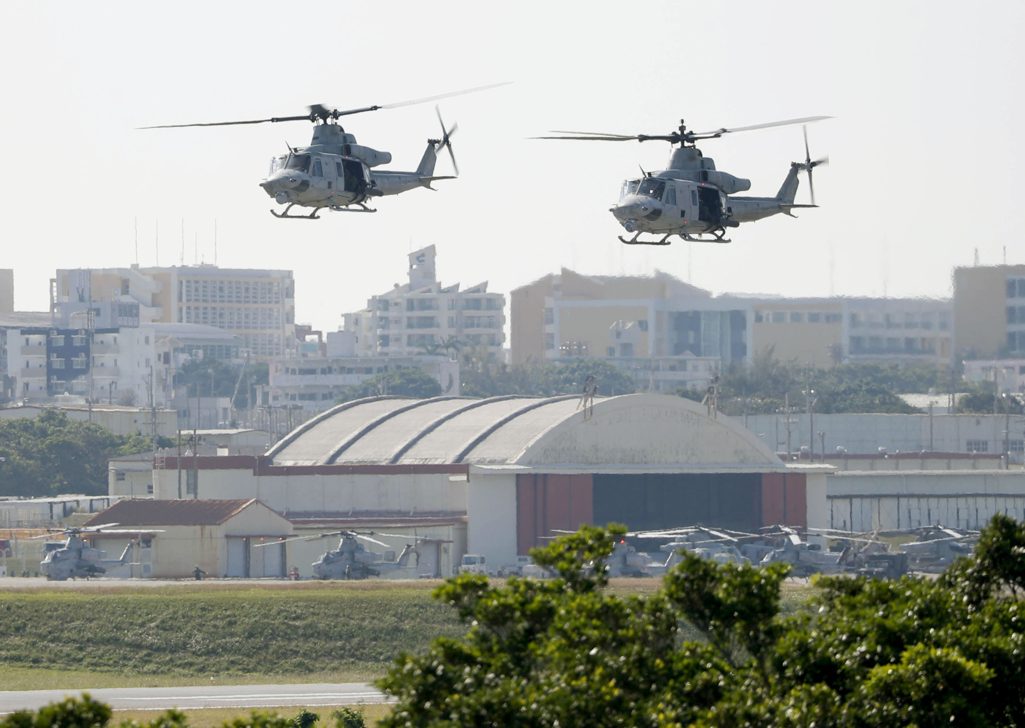Helicopters take off from the U.S. Futenma air base in Ginowan, Okinawa Prefecture.   KYODO