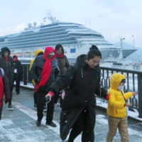 Chinese tourists arrive at Nagasaki Port in January 2018. Japan is the most popular foreign travel destination for Chinese during the weeklong Lunar New Year holiday period this year, according to Chinese online travel agency Ctrip. | KYODO
