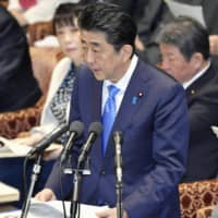 Prime Minister Shinzo Abe speaks about the repatriation of Japanese nationals from the virus-hit Chinese city of Wuhan at a Lower House Budget Committee on Monday. | KYODO