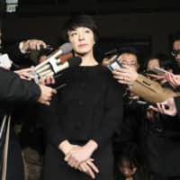 Upper House lawmaker Anri Kawai faces reporters on Wednesday night in Tokyo. | KYODO