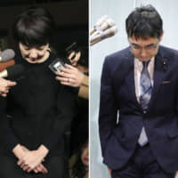 Former Justice Minister Katsuyuki Kawai and his wife, Upper House lawmaker Anri Kawai, face reporters Wednesday night in Tokyo. | KYODO