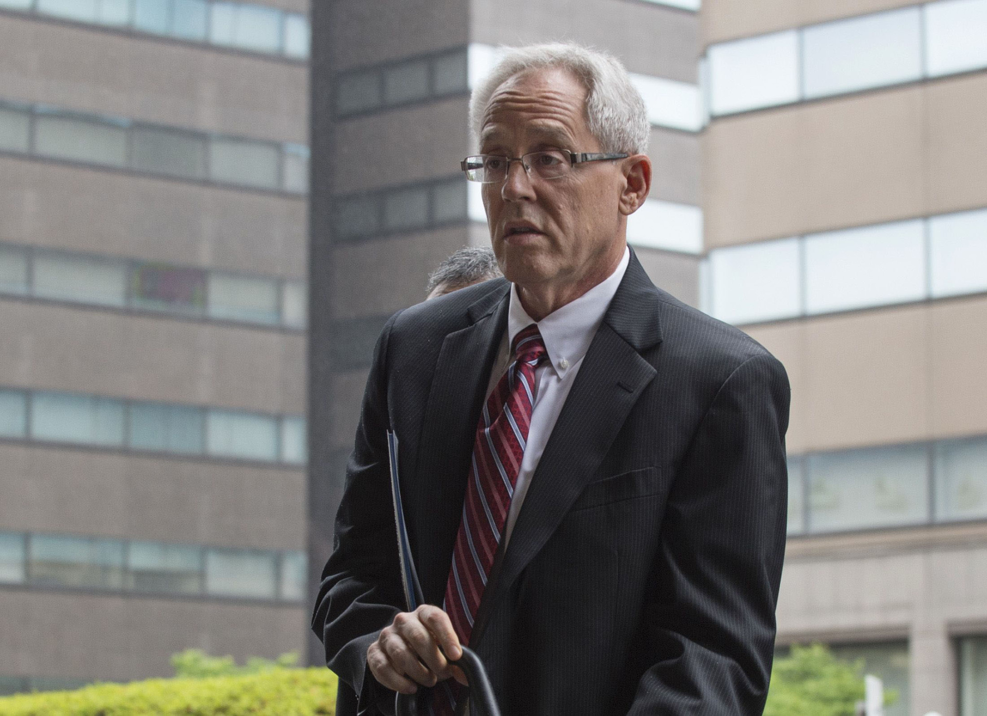 Former Nissan executive Greg Kelly arrives for a pretrial hearing at the Tokyo District Court on June 24. | GETTY IMAGES VIA BLOOMBERG