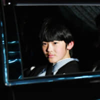 Prince Hisahito, who is in second in the imperial throne succession line, enters the Imperial Palace in Tokyo on Dec. 23. On Thursday, 57-year-old Kaoru Hasegawa admitted during the first court hearing of his case to trespassing into the prince's junior high school in Tokyo. | KYODO