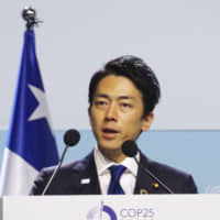 Environment Minister Shinjiro Koizumi makes a speech during a ministerial meeting at a U.N. climate conference in Madrid on Dec. 11. | KYODO