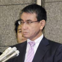 Defense Minister Taro Kono speaks to reporters at his ministry in Tokyo on Wednesday. | KYODO