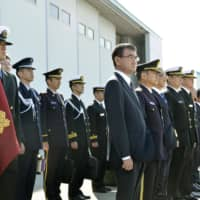 Defense Minister Taro Kono (center) attends a sendoff ceremony for two Maritime Self-Defense Force P-3C patrol planes at Naha airport in Okinawa Prefecture on Saturday. | KYODO