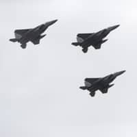 Self-Defense Force jets take part in an annual review at Ground Self-Defense Force camp Asaka in 2018. | BLOOMBERG