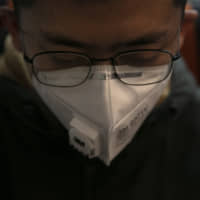 Surgical masks are in short supply as people rush to get them amid the continuing spread of the new coronavirus. | AP