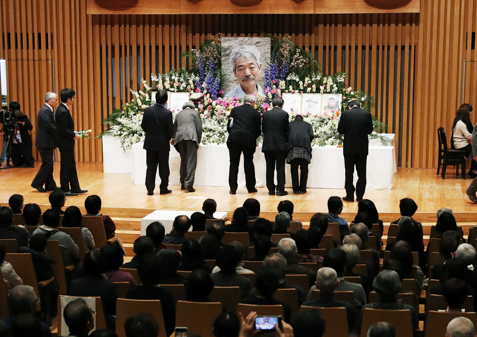 People honor Dr. Tetsu Nakamura, a famed humanitarian aid doctor slain in Afghanistan, at a farewell ceremony held Saturday in the city of Fukuoka. | KYODO
