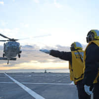 All crew rescued after U.S. Navy chopper crashes off Okinawa