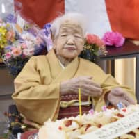 Kane Tanaka, the world's oldest person, who turned 117 on Thursday, is the center of attention at a party to mark the event held Sunday at the nursing home where she lives in Fukuoka. | KYODO