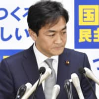Democratic Party for the People head Yuichiro Tamaki faces the media during a news conference Monday at the party's headquarters in Tokyo. | KYODO