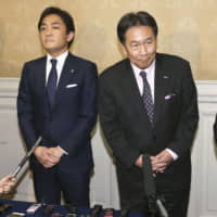 Democratic Party for the People leader Yuichiro Tamaki (left) and Yukio Edano, who heads the Constitutional Democratic Party of Japan, face reporters on Jan. 10 at the Diet after holding talks on a possible merger. | KYODO
