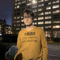Australian freelance journalist and father Scott McIntyre stands in front of Tokyo District Court on Wednesday after  receiving a suspended six-month prison term for illegally entering a building complex where his in-laws live. He calls for changes in the law that typically give mothers custody rights of children after divorce. | MAGDALENA OSUMI