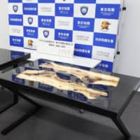 Confiscated tables that contained stimulants within the tabletops are shown to the media on Monday at the Haneda branch of Tokyo Customs. | KYODO