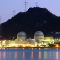 The No. 3 and No. 4 reactor buildings at Kansai Electric Power Co.'s Takahama nuclear power station in Takahama, Fukui Prefecture | BLOOMBERG
