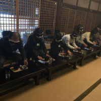 Participants experience what it is like to be visually impaired during an event at Henjoin Temple in Ageo, Saitama Prefecture. | COURTESTY OF NPO MINORI