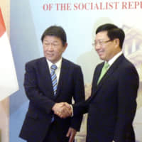Japan and Vietnam vow to uphold rule of law in South China Sea as top diplomats meet