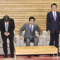 Prime Minister Shinzo Abe attends a Cabinet meeting with other ministers on Tuesday. | KYODO