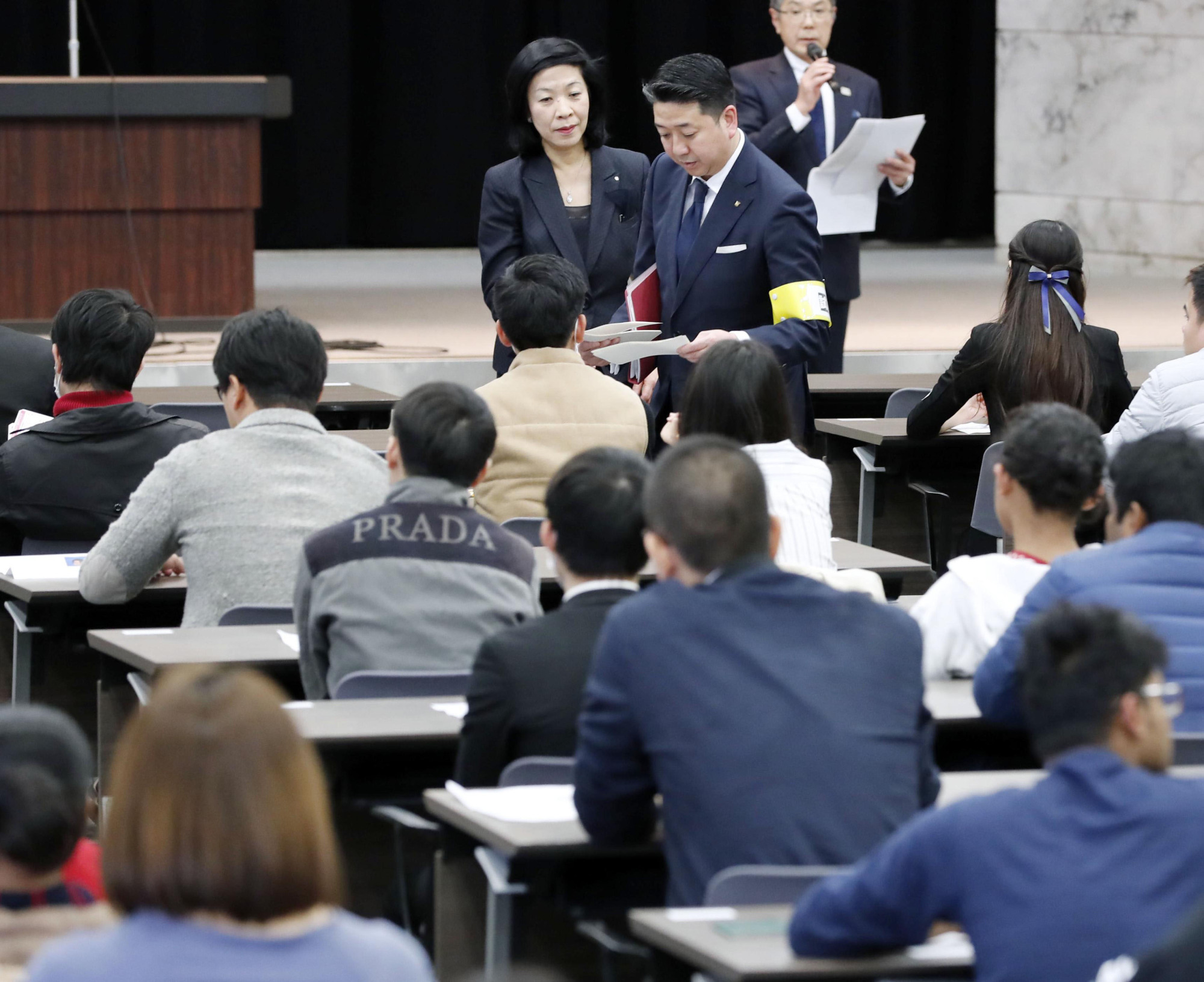 Foreign nationals seeking the new 'specified skills' visa must pass a skills test and a Japanese-language proficiency examination. | KYODO
